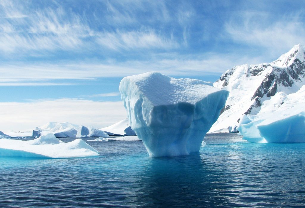 iceberg peaking out of water